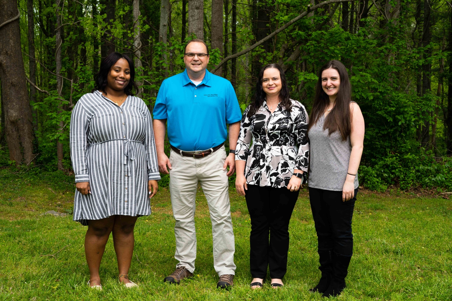 4 Members of Asheville Neurology Specialists Experience Department In Front of Trees