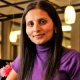 Payal Soni-Patel, PA-C Physician Assistant Smilling In a Purple Turtleneck