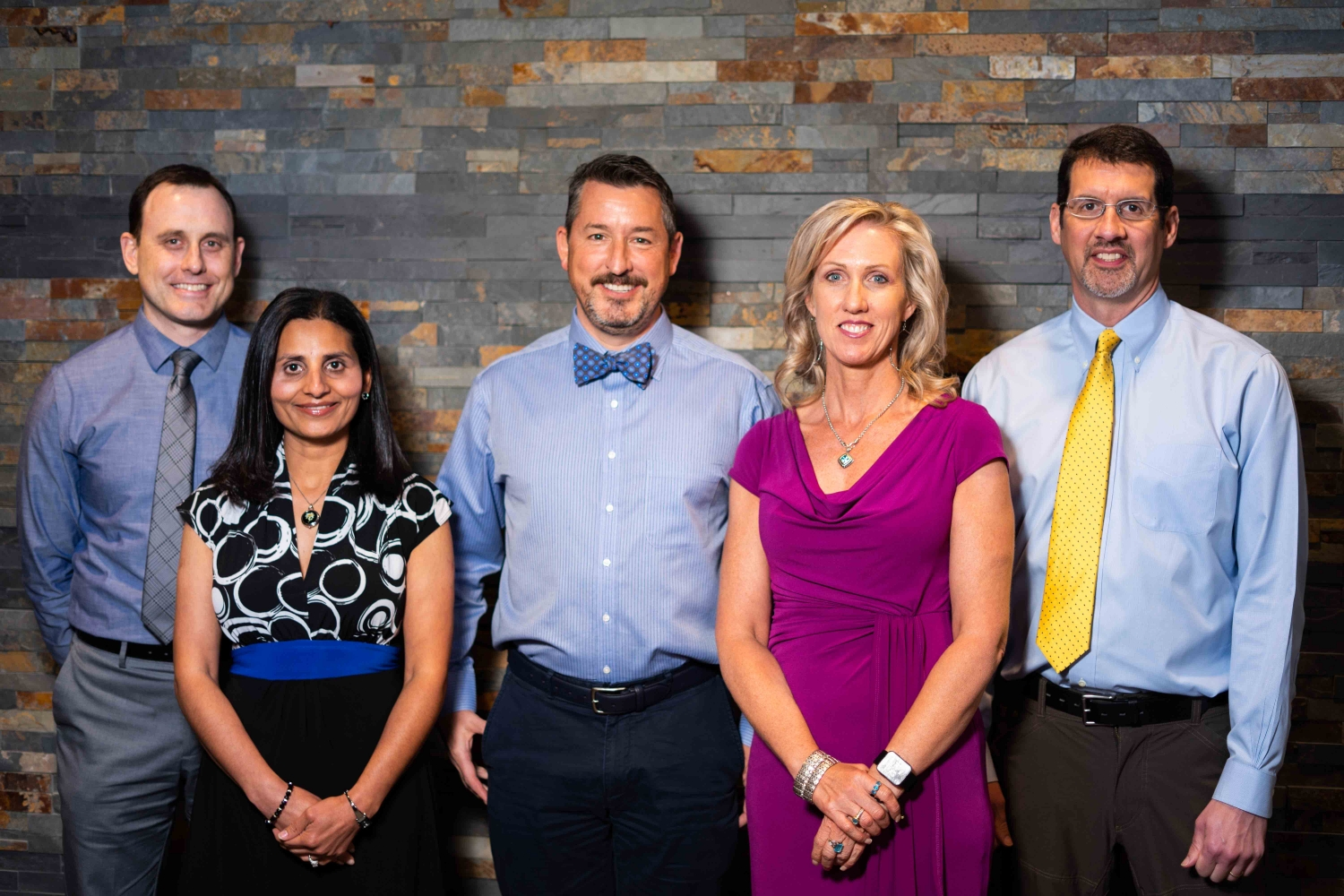 3 Neurologists & 2 Physicians Assistants from Asheville Neurology Specialists Standing In Front of a Wall