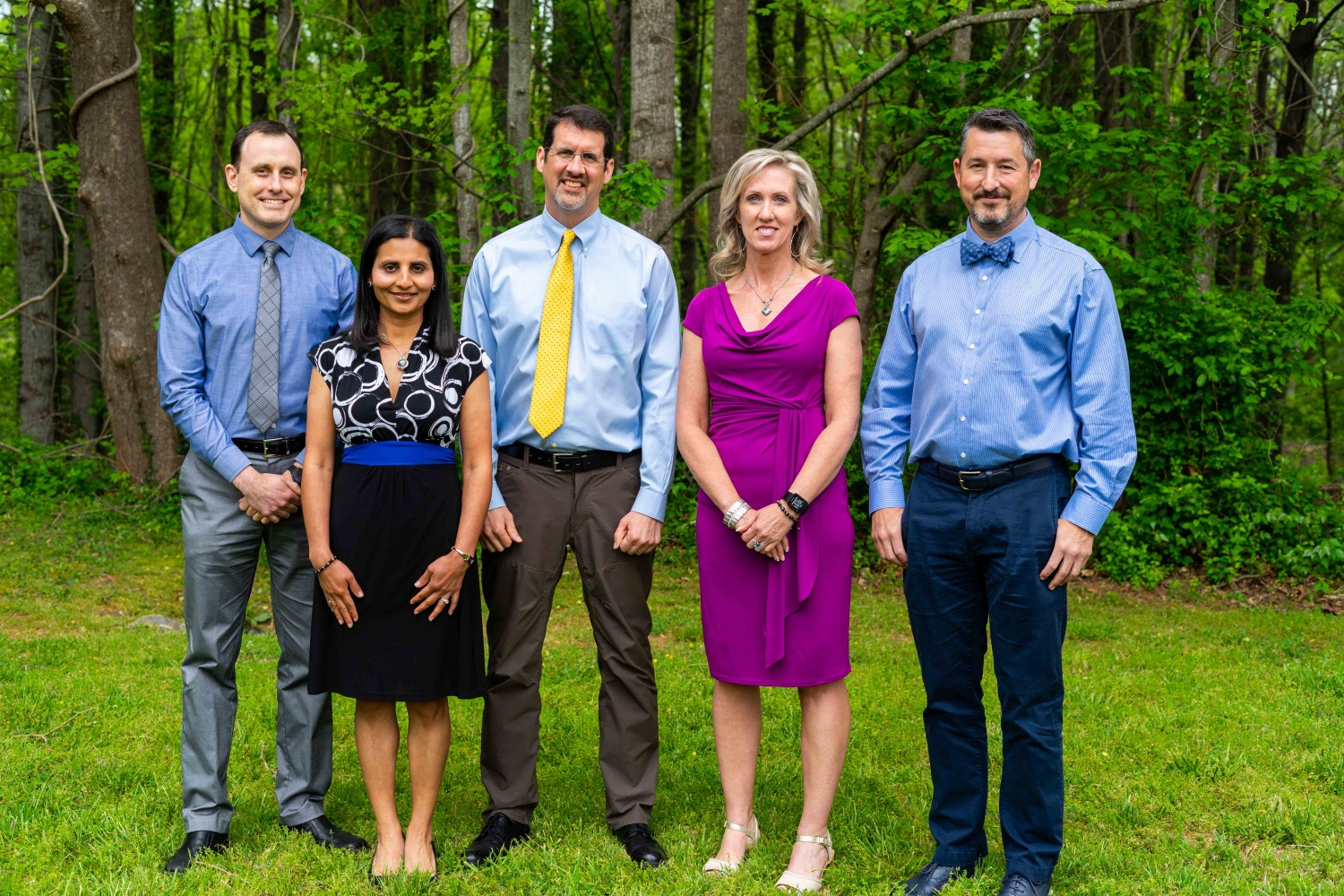 3 Neurologists & 2 Physicians Assistants from Asheville Neurology Specialists Standing In The Woods