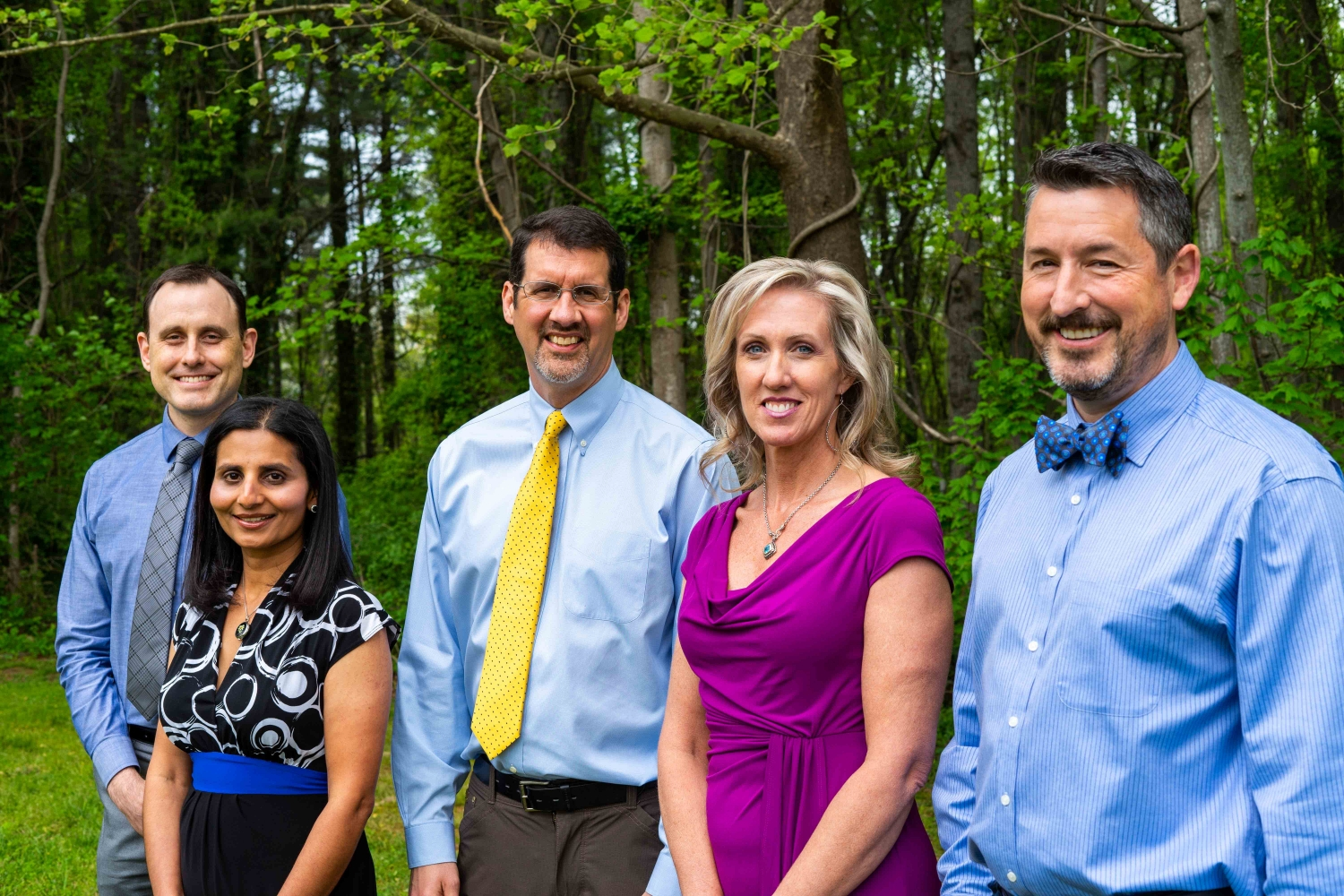 Asheville Neurology Specialists Team Standing In The Woods Smiling